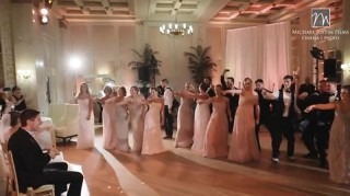 Bridal party dancing in surprise wedding flash mob