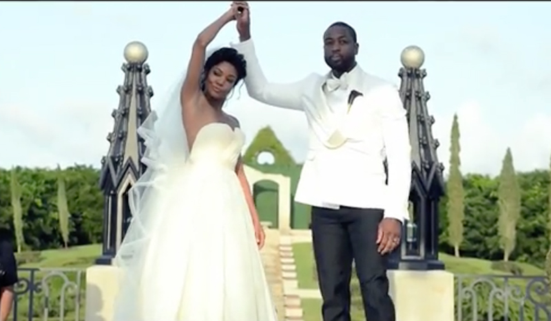 Gabrielle Union and Dwyane Wade perform wedding hdandshake