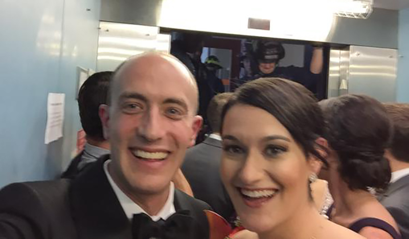 Bride and groom take selfie while stuck in an elevator.