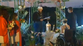 Emily Linneman sits in wheelchair at wedding altar