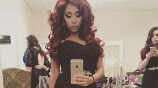 Snooki taking selfie of bridesmaid dress