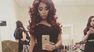 Snooki taking selfie of bridesmaid dress