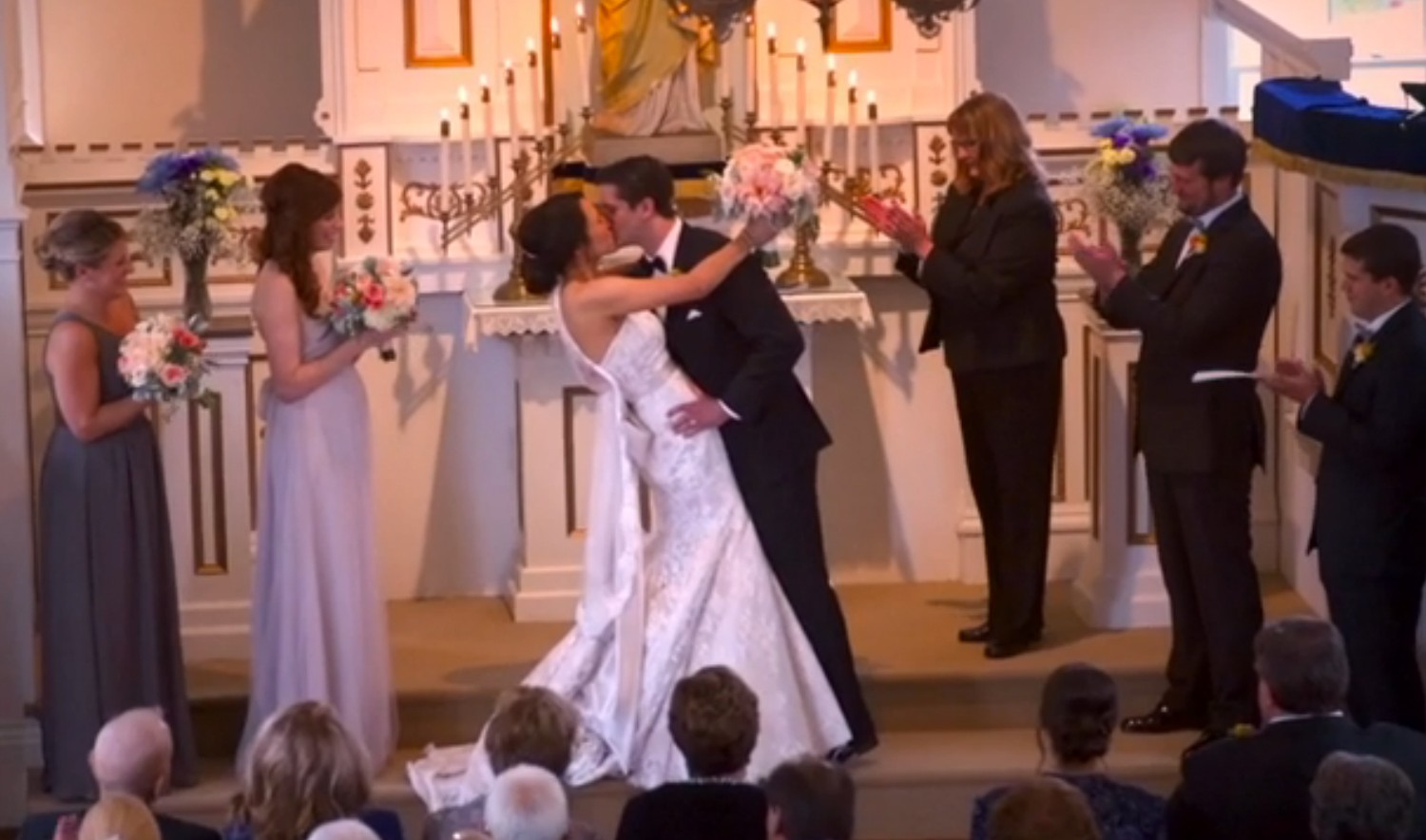 ESPN commenters Kate and Brandon kiss at wedding ceremony