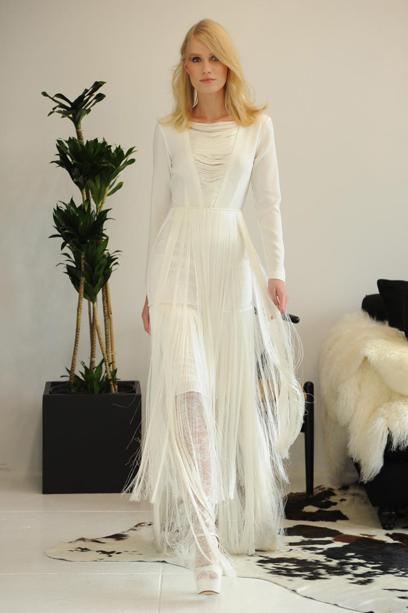 Model Walks In A Houghton Convertible Wedding Dress