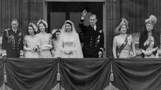 Queen Elizabeth and Prince Philip standing on Buckingham Palace balcony after wedding