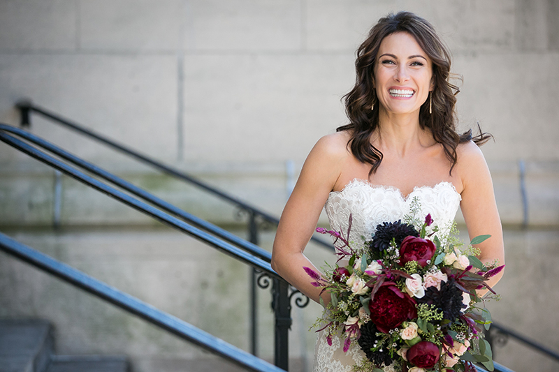 Laura Benanti holding her fall bridal bouquet