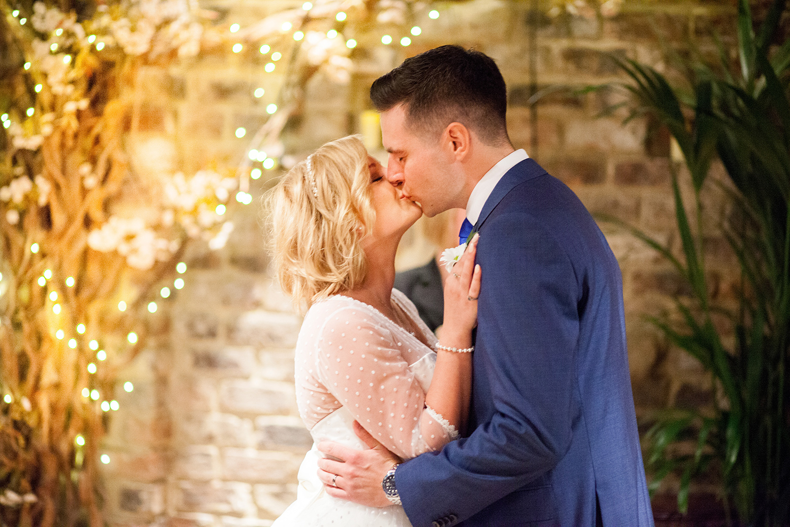 Groom and bride sharing a kiss