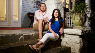 Married at First Sight's David Norton and Ashley Doherty sitting in front of their house