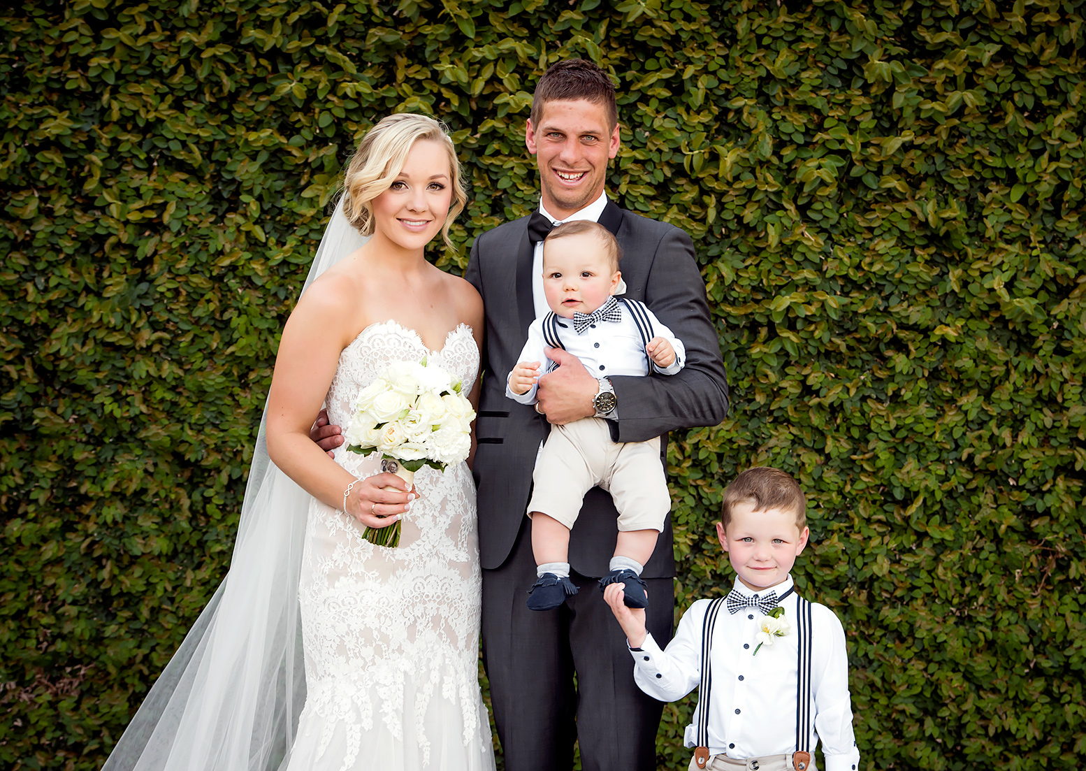 Hannah Lienert and Benny Lienert with their childres on their wedding day.