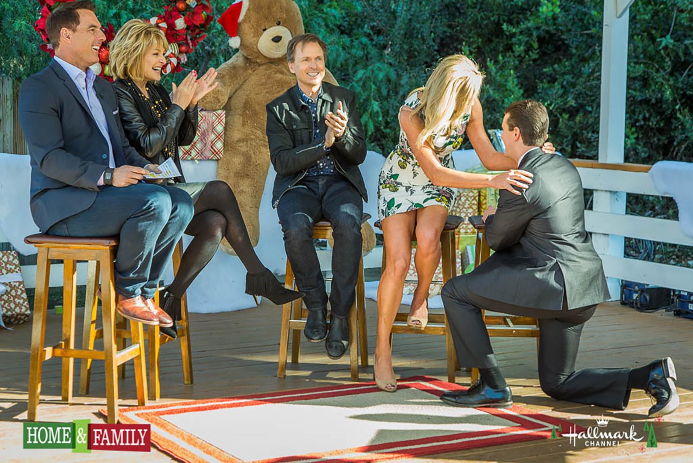Joey Buttitta down on one knee proposing