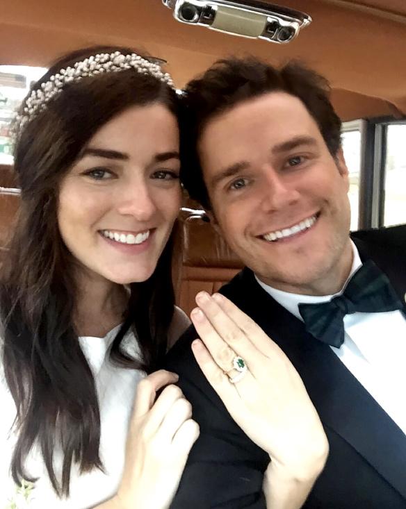 Sarah Vickers and Kiel James Patrick posing after wedding