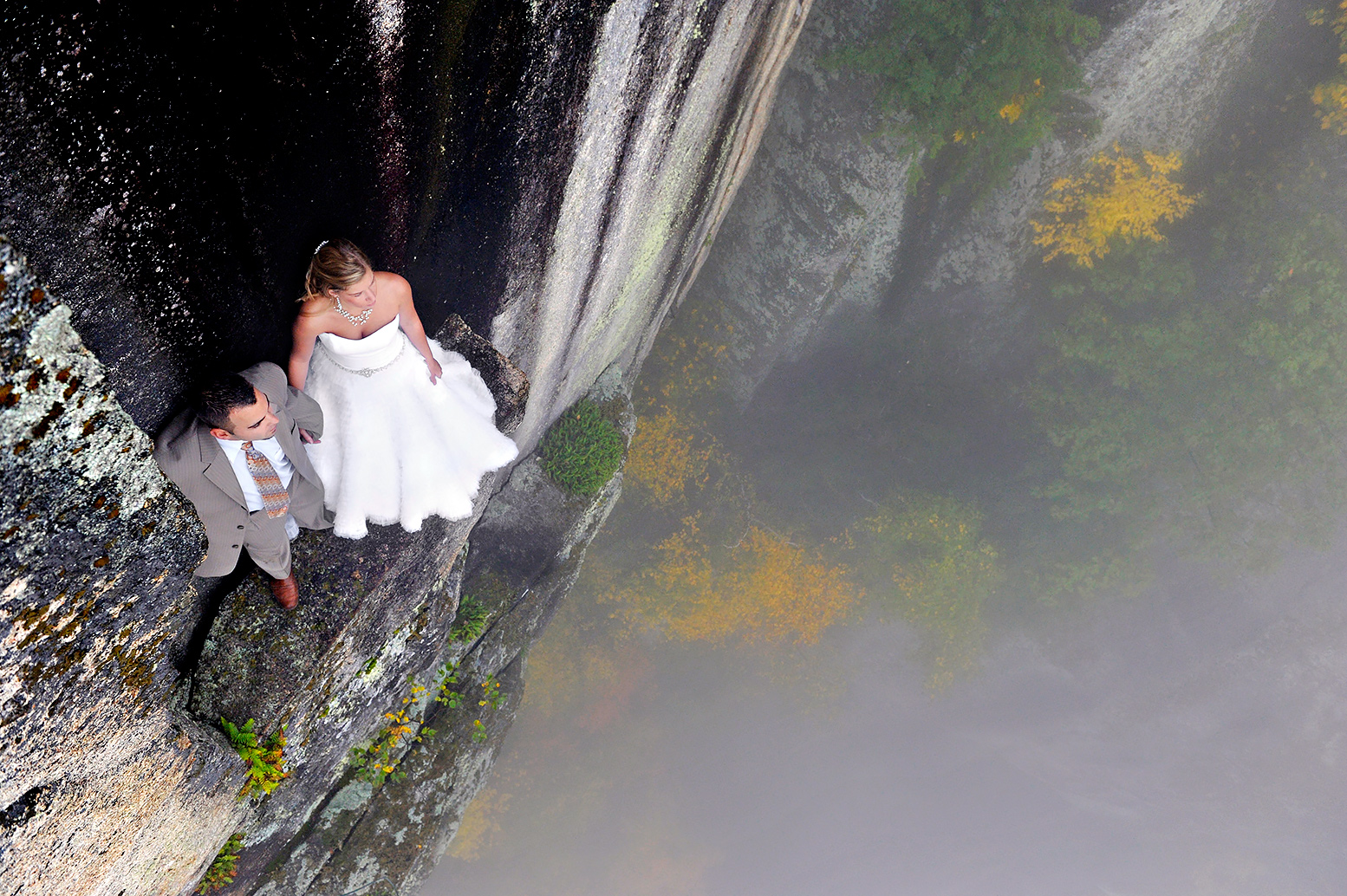 Newlyweds Pose In An Extreme Wedding Picture Taken On The White Mountains Of New Hampshire