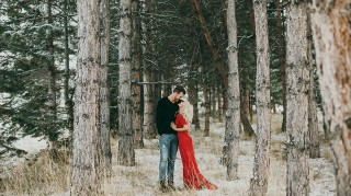 Witney Carson and Carson McAllister pose in snowy forest for engagement phtoos