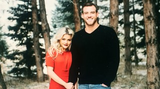 Witney Carson and Carson McAllister hold hands in forest