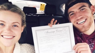Witney Carson and Carson Mcallister holding marriage license