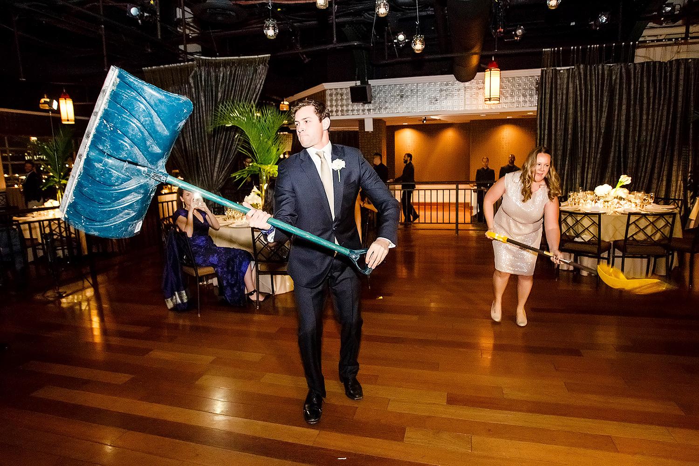 Bridal party shoveled snow at wedding reception