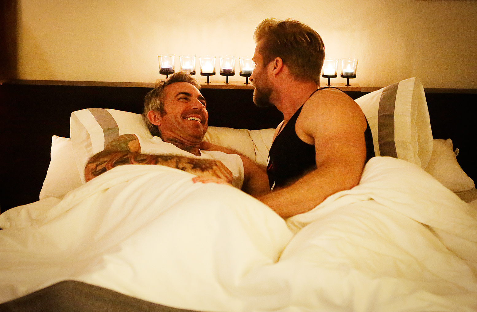 Newlyweds The First Year's Craig Ramsay and Brandon Liberati cuddling in bed