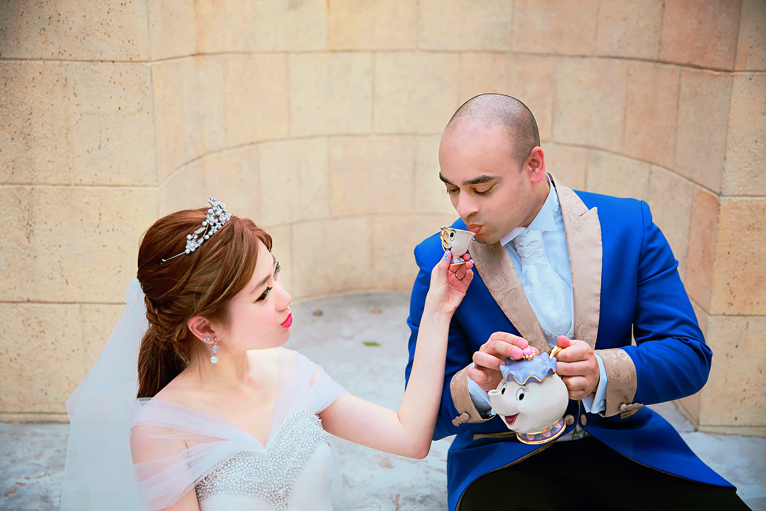 Bride and groom drinking tea from Disney's Beauty and the Beast