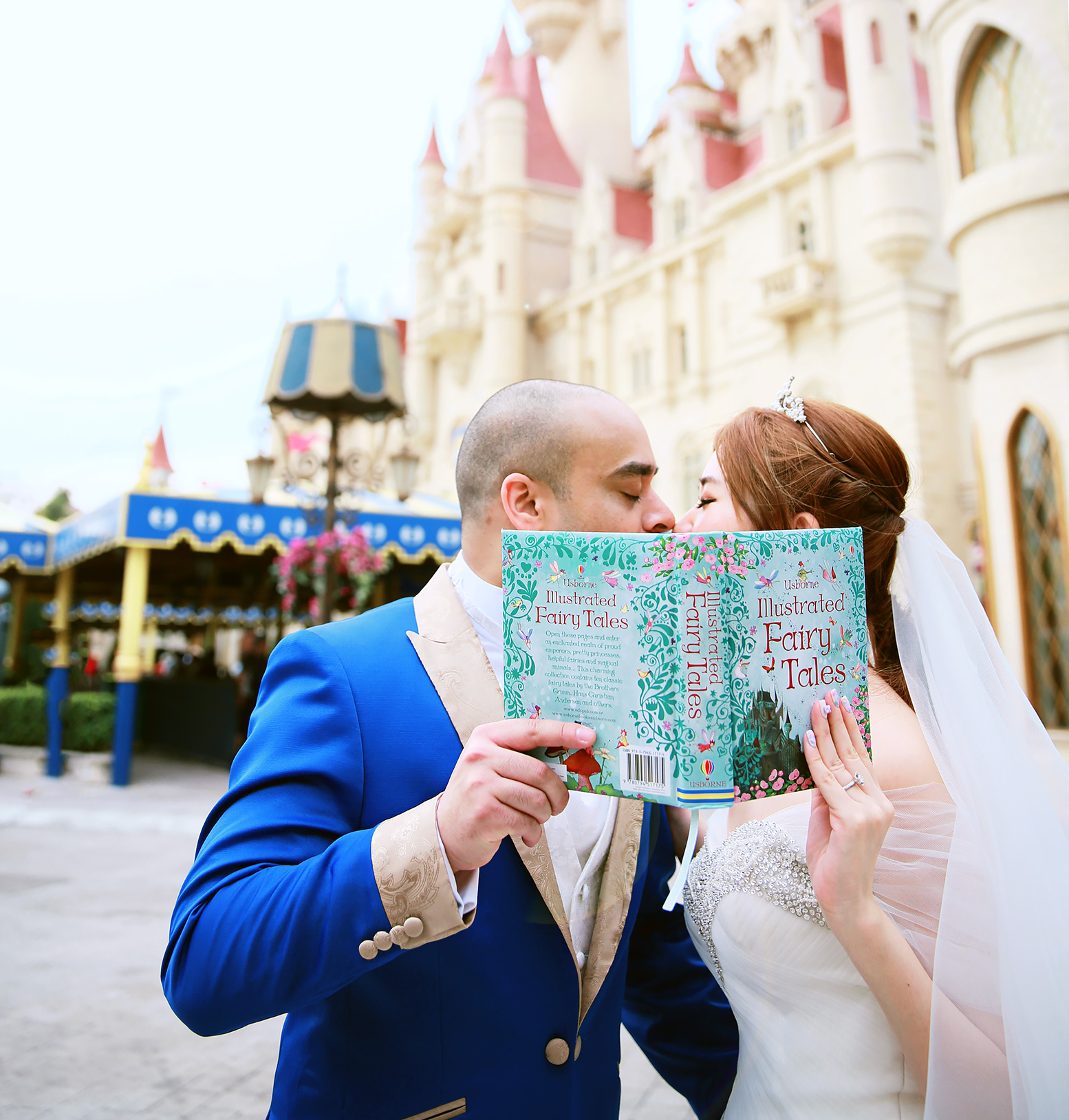 Bride and groom posing with Disney fairy tales