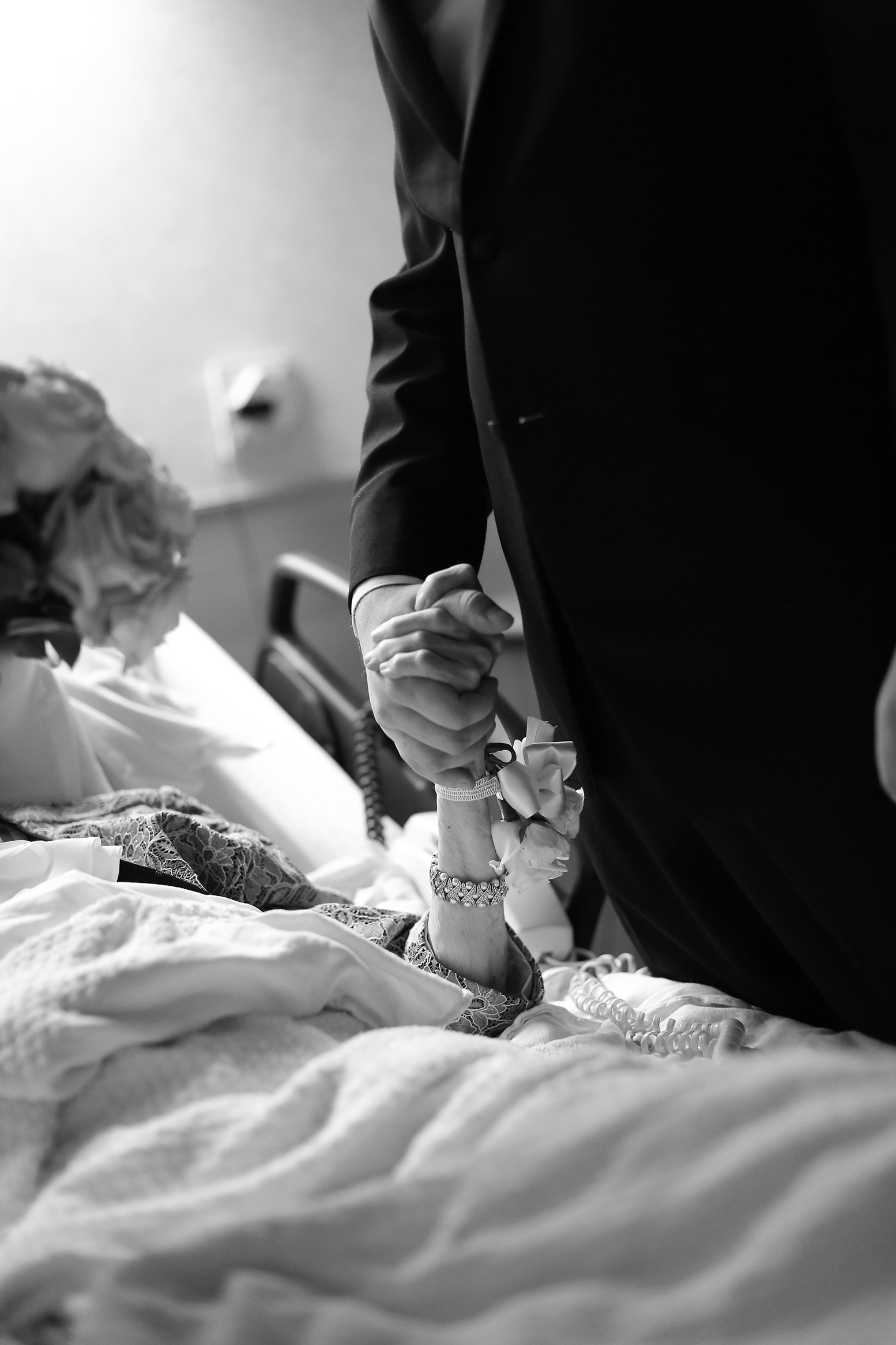 Groom holding his grandmother's hand