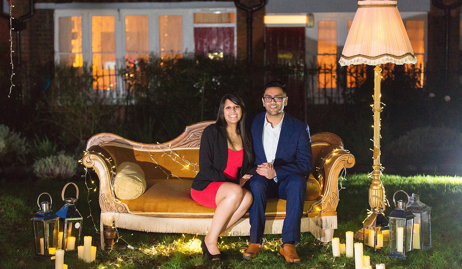 Mitesh and Anisha engagement photo on Friends couch