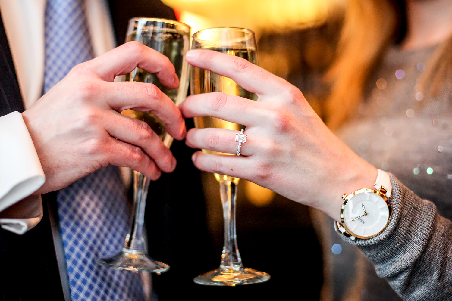 Nat and Colleen celebrate their engagement with champagne. Credit: James Ambler/Paparazzi Proposals