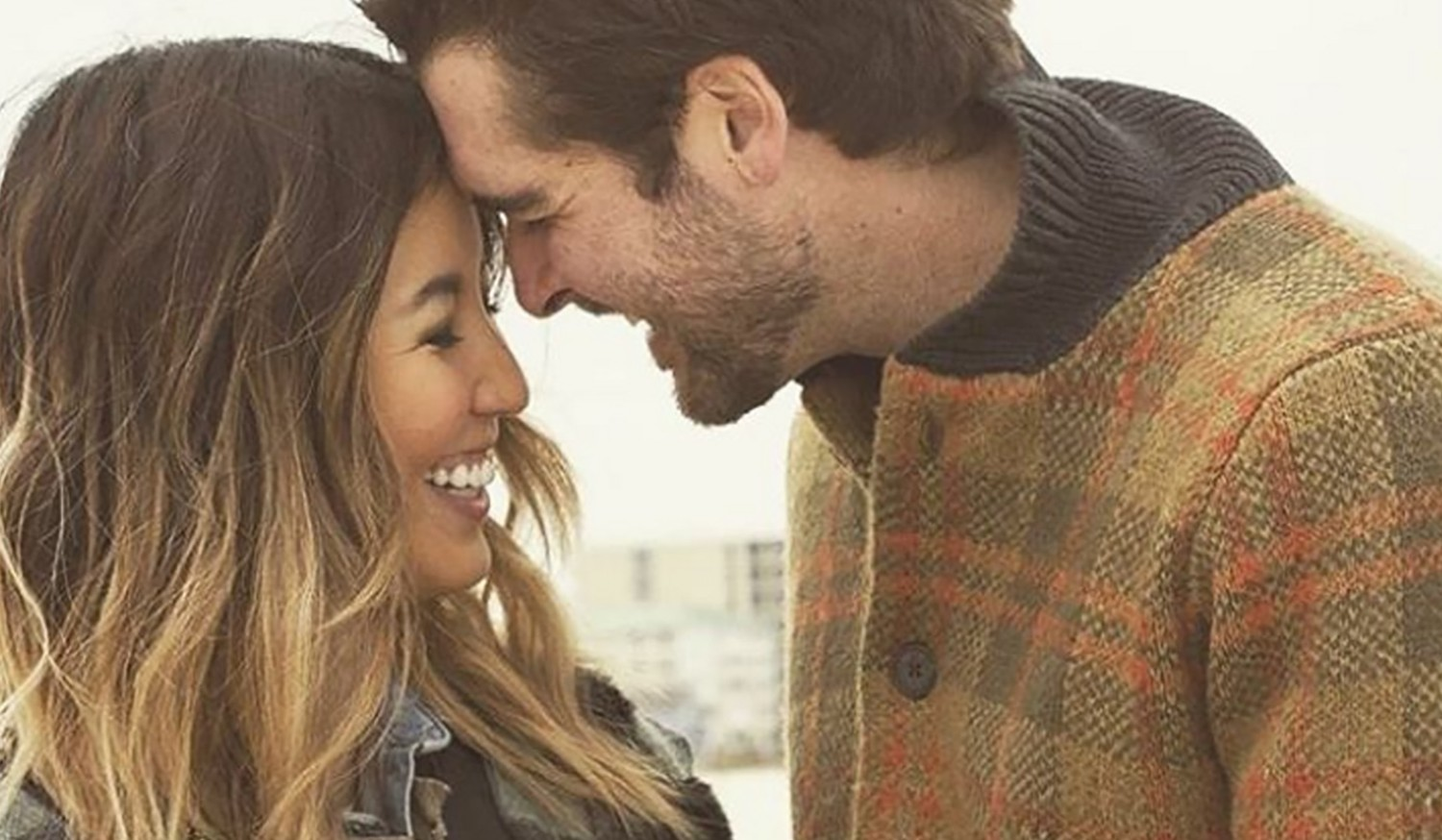 Rebecca Robertson and Johnreed Loflin pose in engagement photo