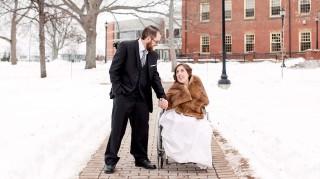 Trevor and Charlotte holding hands after wedding ceremony