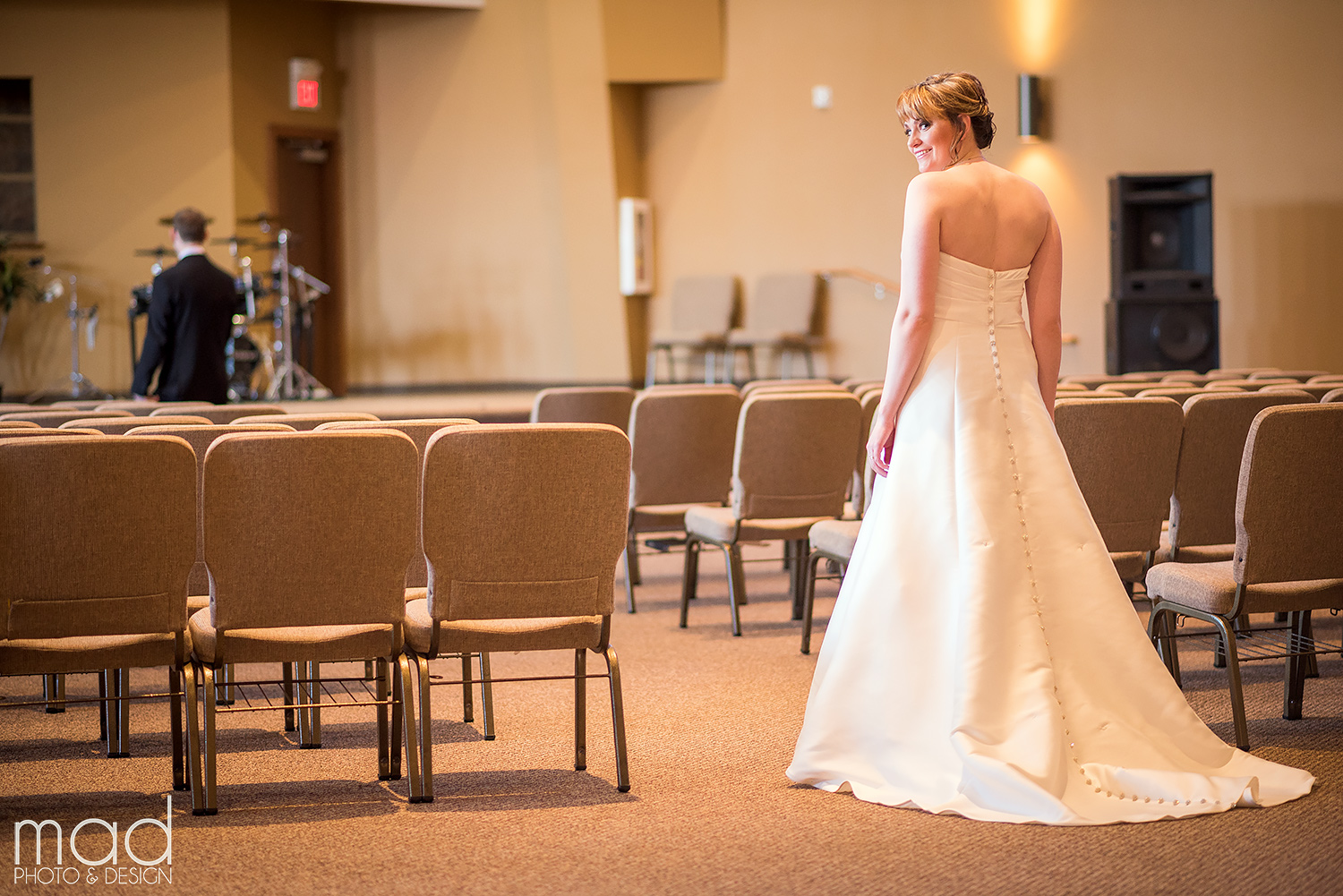 Valerie wore a strapless wedding dress with beautiful buttons down the back. Credit: Mad Photo & Design