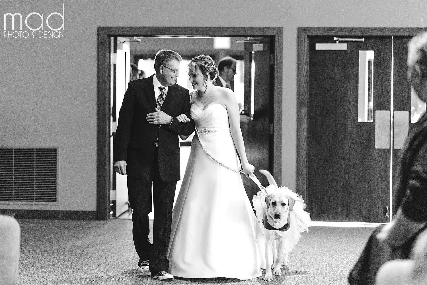 Valerie's service dog, Bella, helped escort her down the aisle on her wedding day. Credit: Mad Photo & Design
