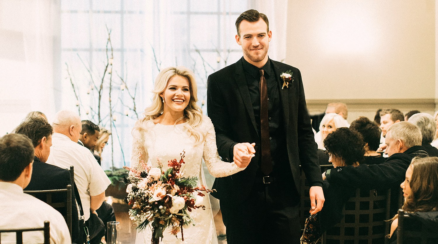 Witney Carson and Carson McAllister walk down the aisle