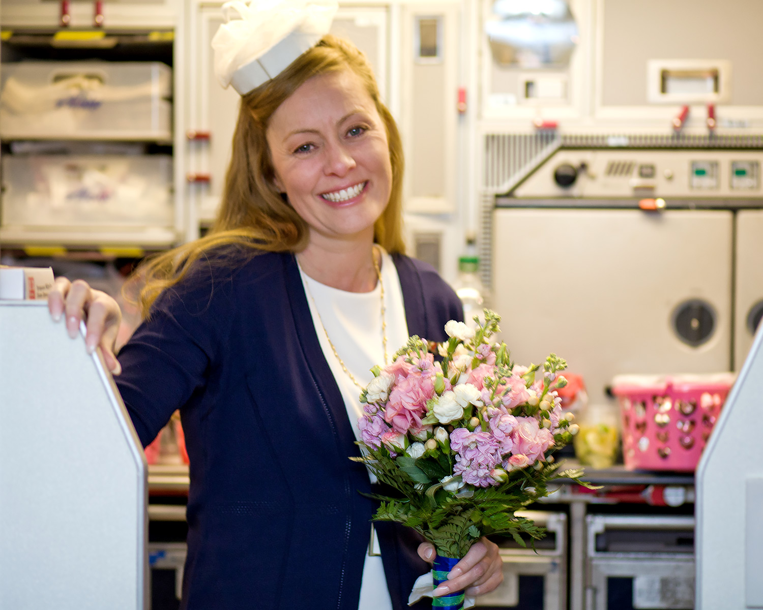 Bride Kristy holding bridal bouquet during airplane wedding