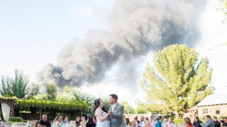 Smoke from fire behind wedding first dance