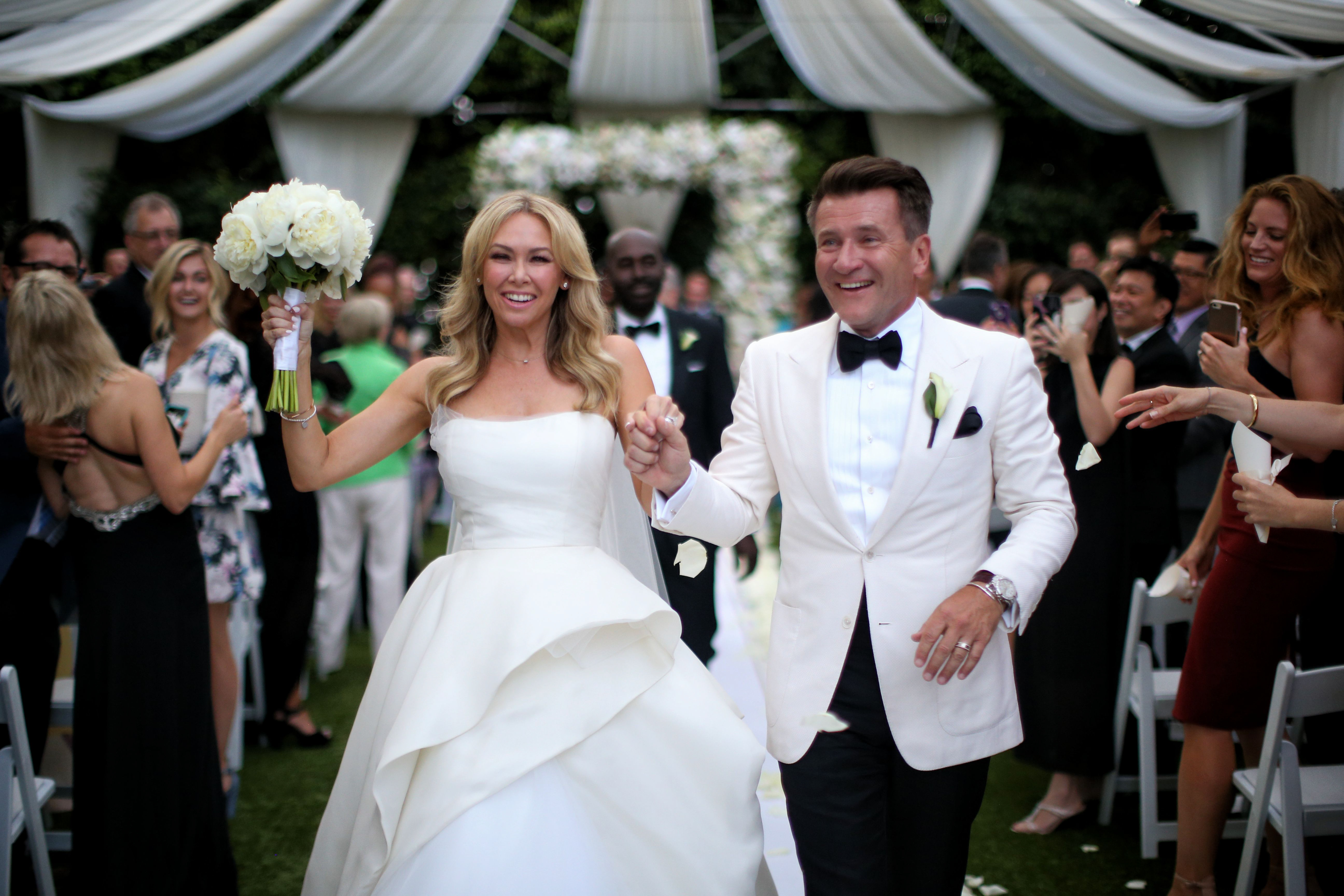 Kym johnson robert herjavec s wedding album new details for Shark tank wedding dress