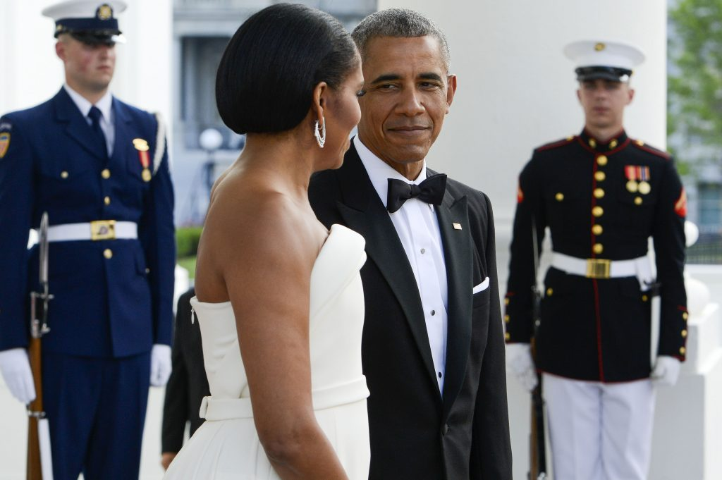 WASHINGTON, DC - AUGUST 02: President Obama and the First Lady Michelle Obama await the arrival of Prime Minister Lee Hsien Loong and Madam Ho Ching at the North Portico of the White House August 2, 2016 in Washington, DC. The Obamas are hosting the prime minister and his wife for an official state dinner. (Photo by Leigh Vogel-Pool/Getty Images)