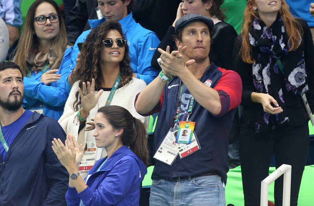 RIO DE JANEIRO, BRAZIL - AUGUST 10: Matthew McConaughey and his wife Camila Alves attend the swimming finals on day 5 of the Rio 2016 Olympic Games at Olympic Aquatics Stadium on August 10, 2016 in Rio de Janeiro, Brazil. (Photo by Jean Catuffe/Getty Images)