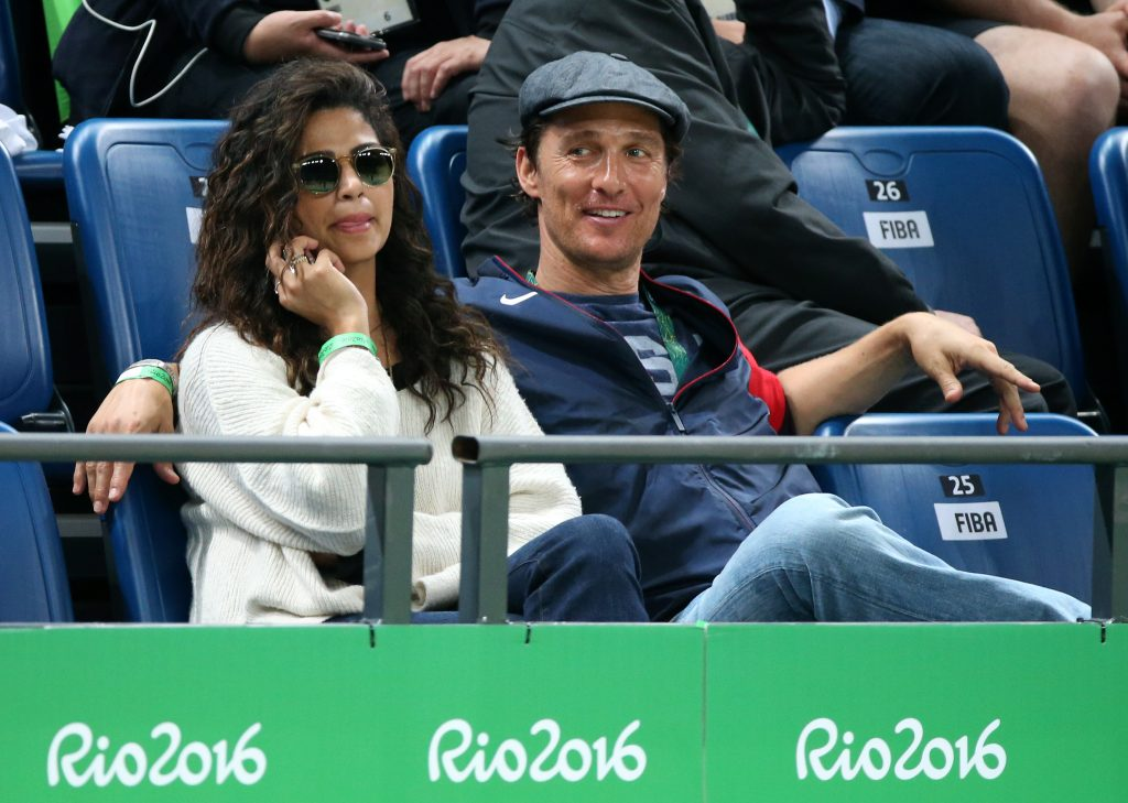 RIO DE JANEIRO, BRAZIL - AUGUST 10: Matthew McConaughey and his wife Camila Alves cheer for Team USA during the basketball match between USA and Australia on day 5 of Rio Olympic Games at Carioca Arena 1 on August 10, 2016 in Rio de Janeiro, Brazil. (Photo by Jean Catuffe/Getty Images)
