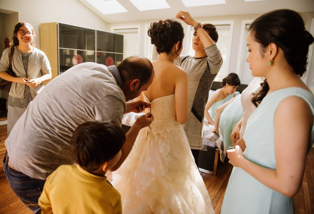Syrian Refugee Mends Brides Dress on the Day of Her Wedding