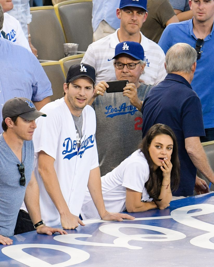 LOS ANGELES, CA - OCTOBER 19: Ashton Kutcher (L) and Mila Kunis attend game 4 of the NLCS between the Chicago Cubs and the Los Angeles Dodgers at Dodger Stadium on October 19, 2016 in Los Angeles, California. (Photo by Noel Vasquez/GC Images)