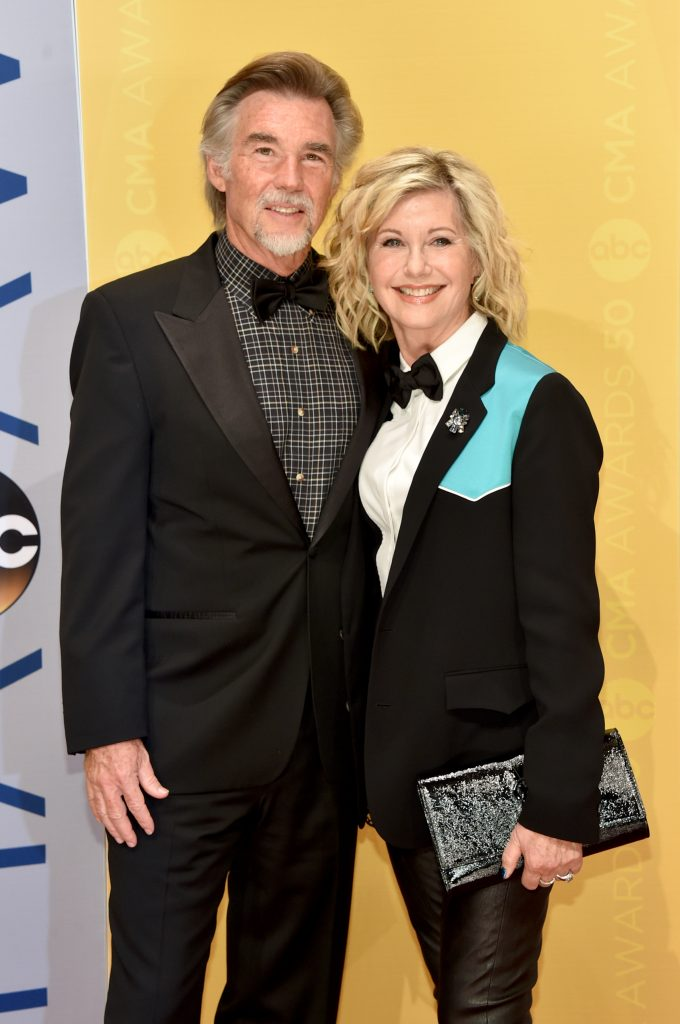NASHVILLE, TN - NOVEMBER 02: John Easterling and Olivia Newton-John attend the 50th annual CMA Awards at the Bridgestone Arena on November 2, 2016 in Nashville, Tennessee. (Photo by John Shearer/WireImage)