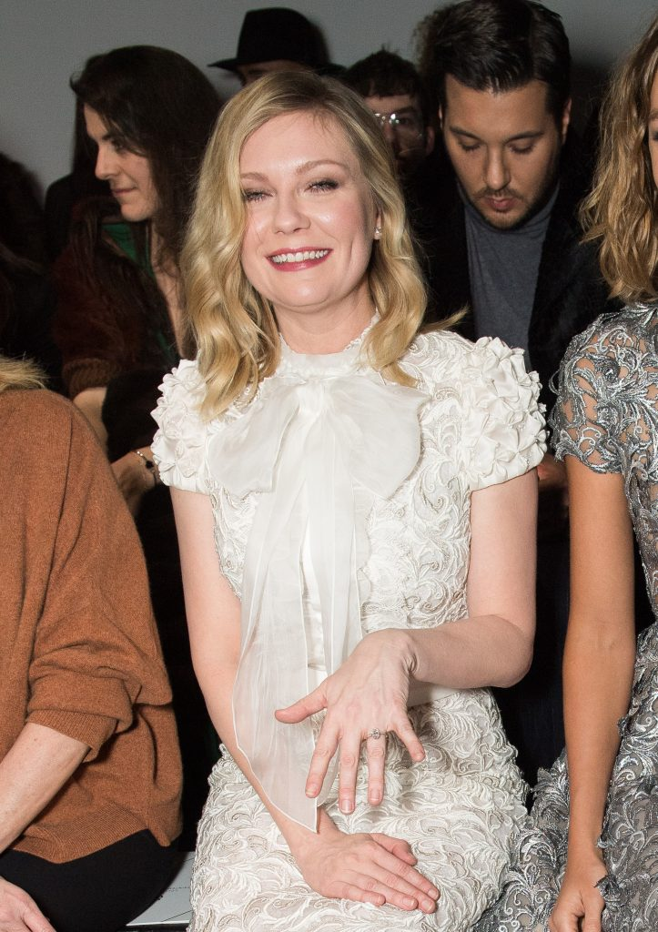 PARIS, FRANCE - JANUARY 23: Kirsten Dunst shows her engagement ring as she attends the Ralph&Russo Haute Couture Spring Summer 2017 show as part of Paris Fashion Week on January 23, 2017 in Paris, France. (Photo by Samir Hussein/Samir Hussein/WireImage)
