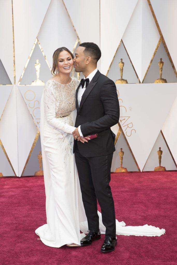 THE OSCARS(r) - The 89th Oscars(r) broadcasts live on Oscar(r) SUNDAY, FEBRUARY 26, 2017, on the ABC Television Network. (ABC/Tyler Golden) CHRISSY TEIGEN, JOHN LEGEND