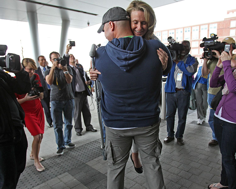 Boston Marathon bombing survivor fireman firefighter engaged