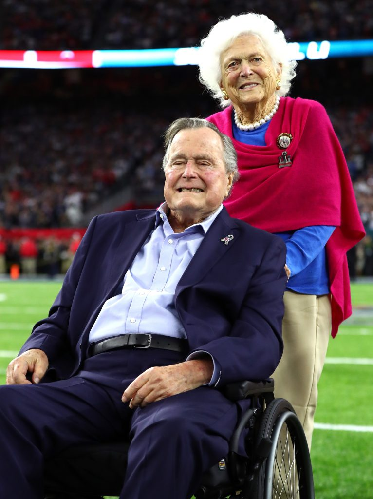 HOUSTON, TX - FEBRUARY 05: President George H.W. Bush and Barbara Bush arrive for the coin toss prior to Super Bowl 51 between the Atlanta Falcons and the New England Patriots at NRG Stadium on February 5, 2017 in Houston, Texas. (Photo by Al Bello/Getty Images)