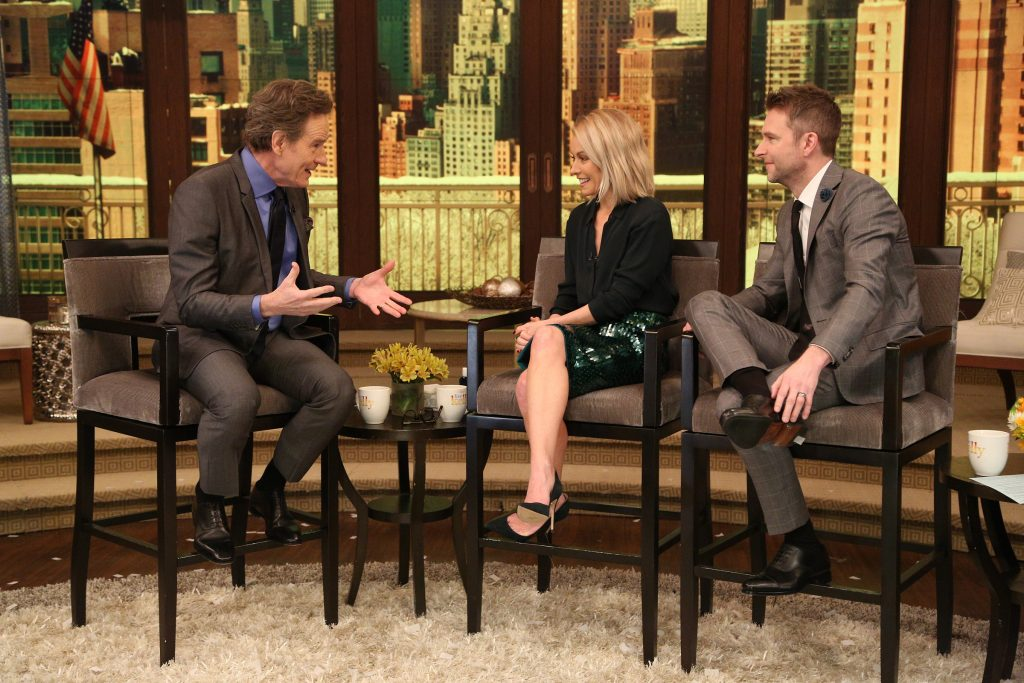 "Kelly Ripa and Chris Hardwick talk with Bryan Cranston during the production of ""LIVE with Kelly"" in New York on Thursday, March 16, 2017. Photo: David M. Russell//Disney/ABC Home Entertainment and TV Distribution ©2017 Disney ABC. All Rights Reserved."