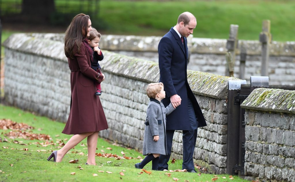 ENGLEFIELD, ENGLAND - DECEMBER 25: Prince William, Duke of Cambridge, Prince George of Cambridge, Catherine, Duchess of Cambridge and Princess Charlotte of Cambridge attend a Christmas Day service at St. Marks Church on December 25, 2016 in Englefield, England. (Photo by Anwar Hussein/WireImage)