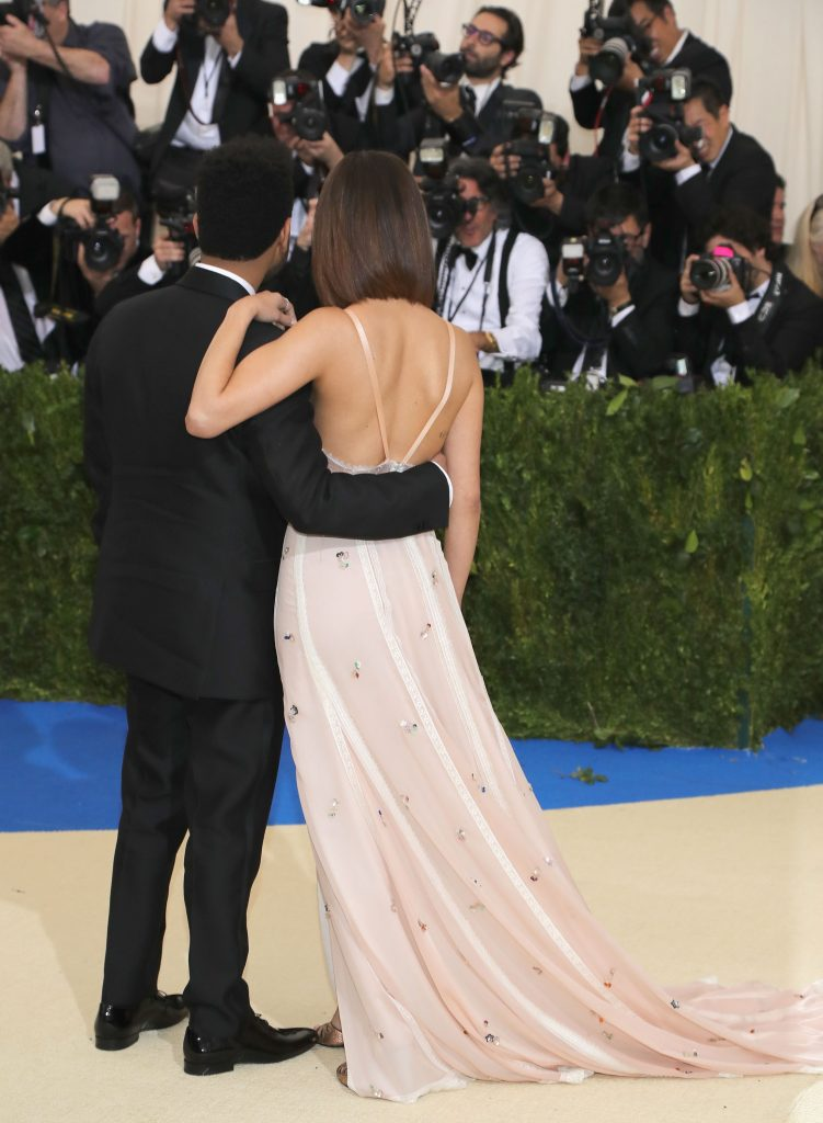 """NEW YORK, NY - MAY 01: The Weeknd (L) and Selena Gomez attend the """"Rei Kawakubo/Comme des Garcons: Art Of The In-Between"""" Costume Institute Gala at Metropolitan Museum of Art on May 1, 2017 in New York City. (Photo by Neilson Barnard/Getty Images)"""