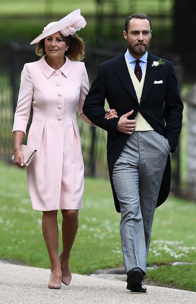 James Middleton (R), brother of the bride, walks with his mother Carole Middleton as they attend the wedding of Pippa Middleton and James Matthews at St Mark's Church in Englefield, west of London, on May 20, 2017. Pippa Middleton hit the headlines with a figure-hugging outfit at her sister Kate's wedding to Prince William but now the world-famous bridesmaid is becoming a bride herself. Once again, all eyes will be on her dress as the 33-year-old marries financier James Matthews on Saturday at a lavish society wedding where William and Kate's children will play starring roles. / AFP PHOTO / POOL / Justin TALLIS (Photo credit should read JUSTIN TALLIS/AFP/Getty Images)