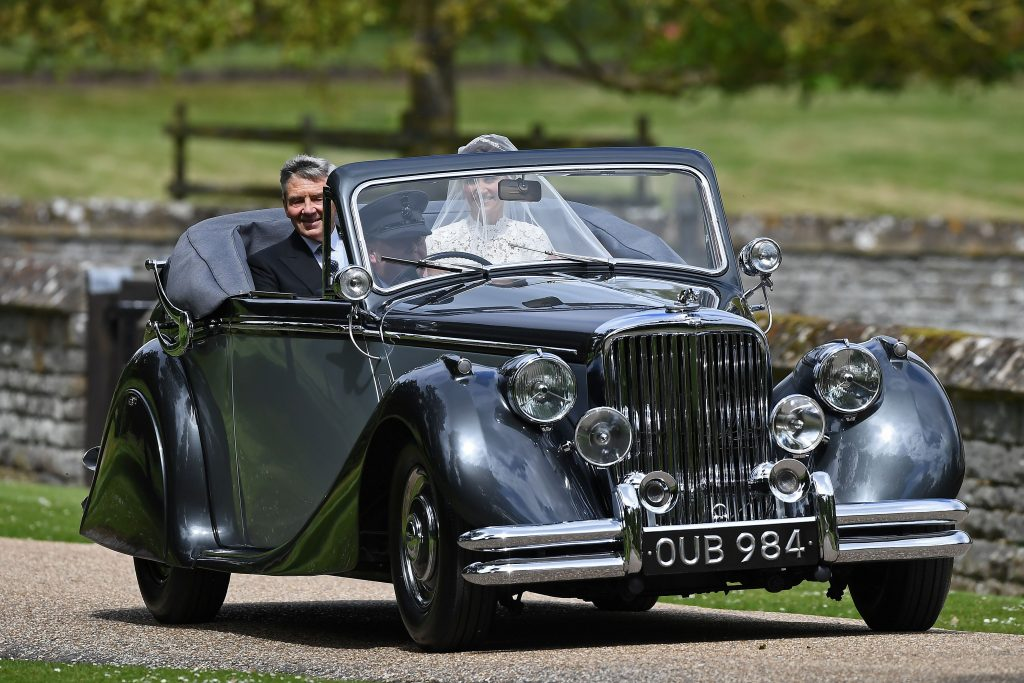 Pippa Middleton, (R) arrives with her father Michael Middleton, in a 1951 Jaguar Mk V car, for her wedding to James Matthews at St Mark's Church in Englefield, west of London, on May 20, 2017. Pippa Middleton hit the headlines with a figure-hugging outfit at her sister Kate's wedding to Prince William but now the world-famous bridesmaid is becoming a bride herself. Once again, all eyes will be on her dress as the 33-year-old marries financier James Matthews on Saturday at a lavish society wedding where William and Kate's children will play starring roles. / AFP PHOTO / POOL / Justin TALLIS (Photo credit should read JUSTIN TALLIS/AFP/Getty Images)