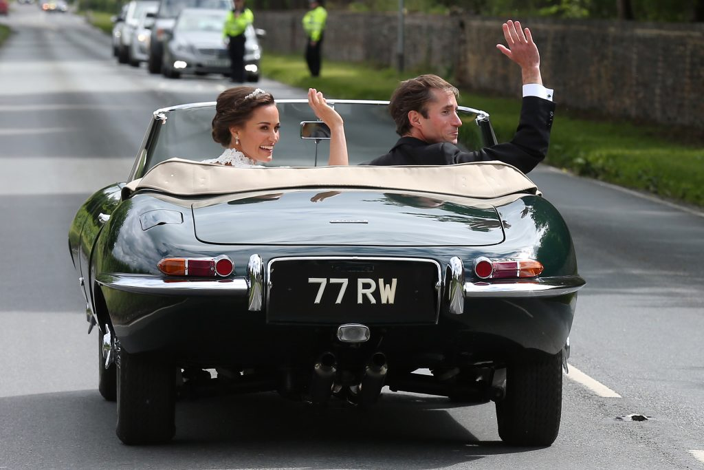 ENGLEFIELD GREEN, ENGLAND - MAY 20: Bride Pippa Middleton and her new husband James Matthews seen leaving St Mark's Church in a classic car after their Wedding Ceremony on May 20, 2017 in Englefield, England. (Photo by Neil Mockford/GC Images)